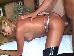 Guy drills hot tranny in high boots