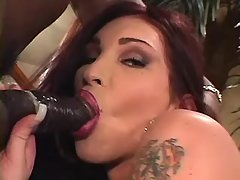 Shemale sucks huge chocolate cock