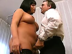 Busty brunette tranny sucked by man