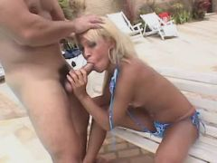 Blond shemale sucking cock outdoor