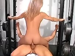Shemale rides cock in gym